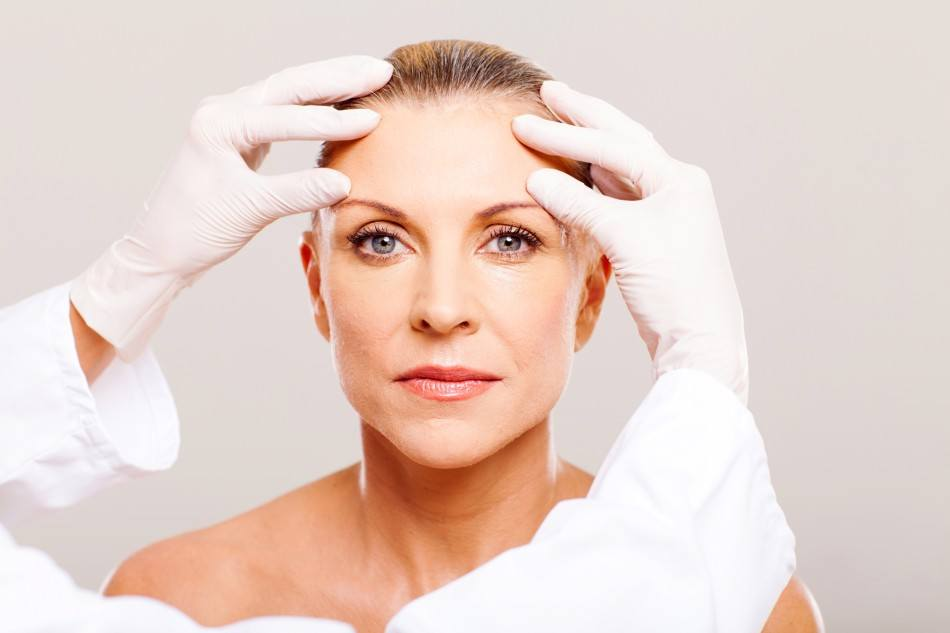 woman getting assessed by dermatologist Toronto