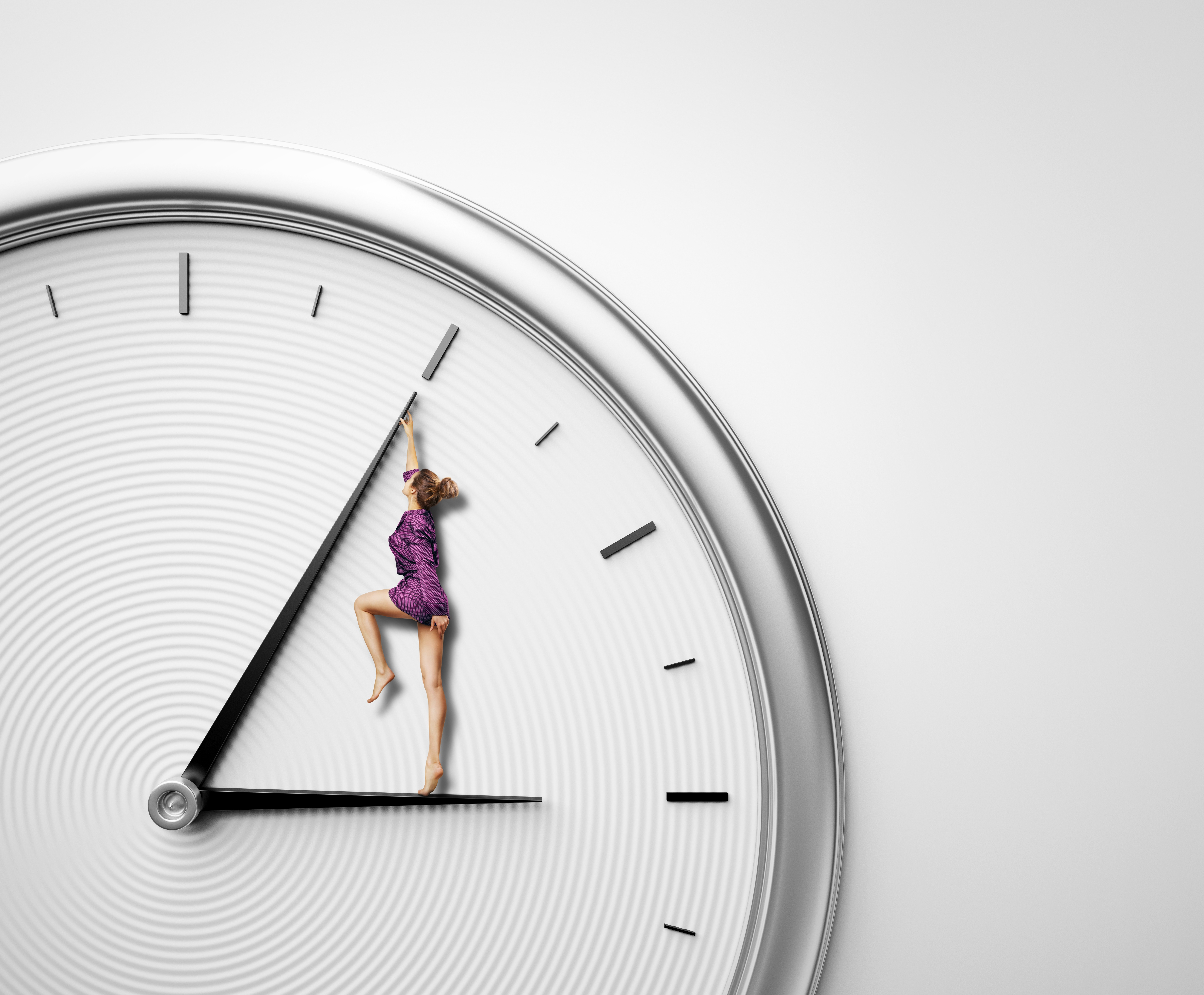 woman in a purple jumper standing on hour hand of clock and pushing minute hand backward